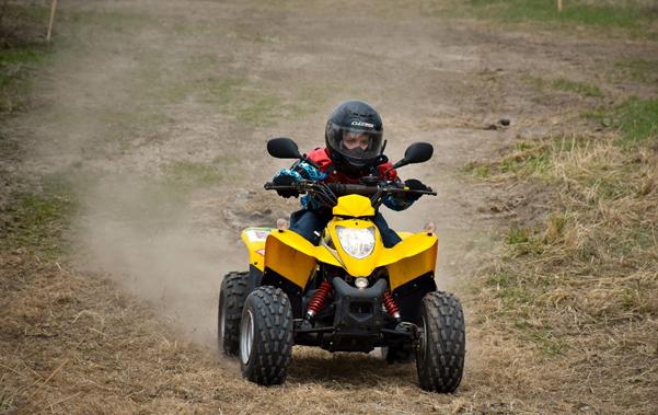 Child on a yellow electric quad bike