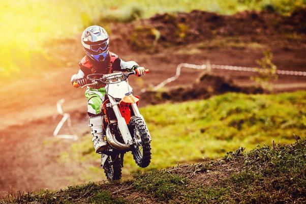 Child riding an electric dirt bike